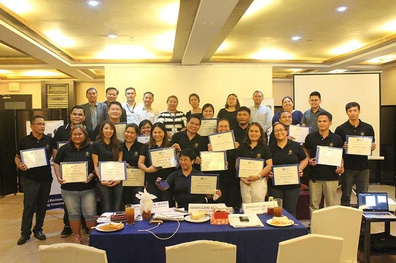 CAGAYAN DE ORO. The 18 small and medium entrepreneurs (SMEs) from Cagayan de Oro City who graduated from the 3-month mentoring program by the Department of Trade and Industry-Misamis Oriental. (Jo Ann Sablad)