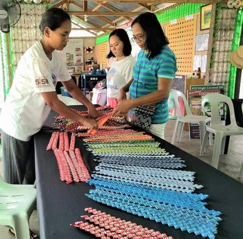 NEGROS. PeacePond lady farmers with members of association of widows make the wallets. (Contributed Photo)