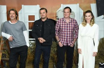 In this July 11, 2019 file photo, Brad Pitt, from left, Leonardo DiCaprio, Quentin Tarantino and Margot Robbie attend the photo call for