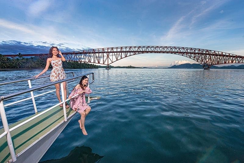 TACLOBAN. Local tourists enjoy the view of the iconic San Juanico Bridge in Tacloban City onboard the San Juanico Cruises operated by Hero Travel and Tours, a new tour company in Eastern Visayas. (Contributed photo)