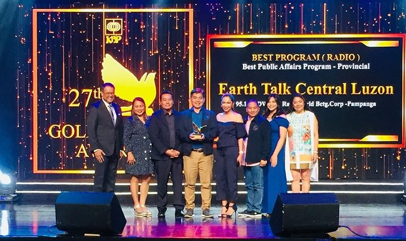 PAMPANGA. Staff of the Regional Public Affairs Office of the Department of Environment and Natural Resources Regional Office accept the award for Best Public Affairs Program for their radio program 'Earth Talk Central Luzon' aired over dwRW 95.1, during the 27th Kapisanan ng mga Brodkaster sa Pilipinas Golden Dove Awards. (DENR photo)