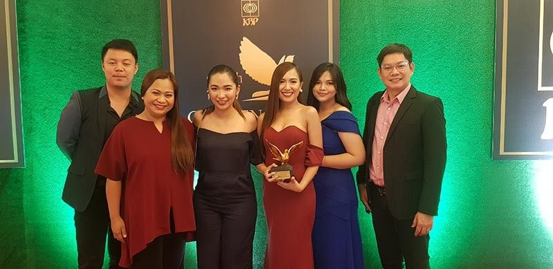 PAMPANGA. The dwRW 95.1 team poses with the station's Golden Dove award for Best Provincial FM Station in the Country, a feat it accomplished for the fourth time. (Contributed Photo)