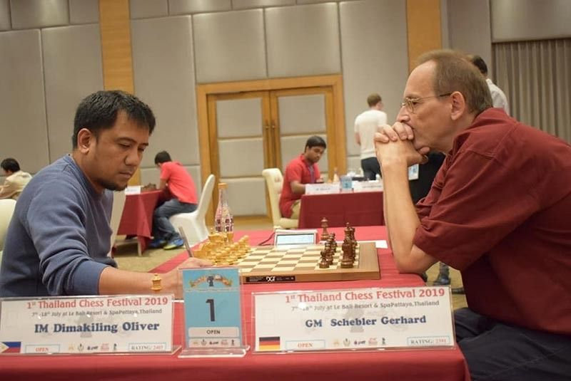 DAVAO. Davao City's international master (IM) Oliver Dimakiling, left, records his move against Germany's grand master (GM) Schebler Gerhard whom he defeated during their eighth round match recently-concluded Thailand Chess Festival Open in Pattaya, Thailand. (Gilbert Castro Pascua Facebook)