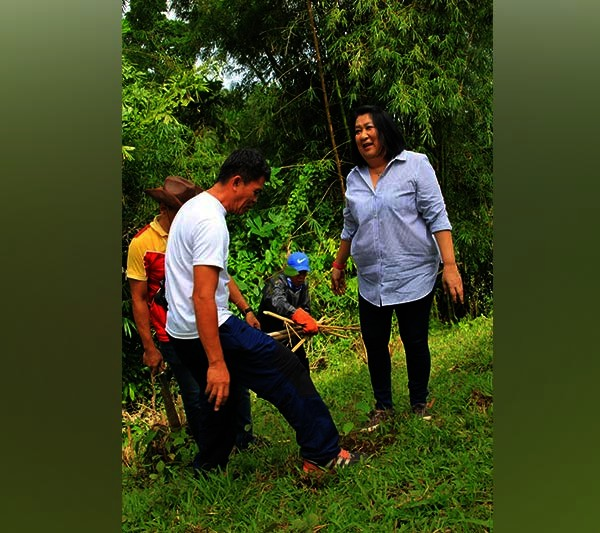CAGAYAN DE ORO. Former Camiguin governor Maria Luisa Romualdo is seen here  with Mayor Jurdin Jesus Romualdo and the staff from the Municipal Government of Mambajao spearheading the planting of 2,019 tree seedlings in Mambajao during the 51st Founding Anniversary of Camiguin island. (Photo courtesy of PIA Camiguin)