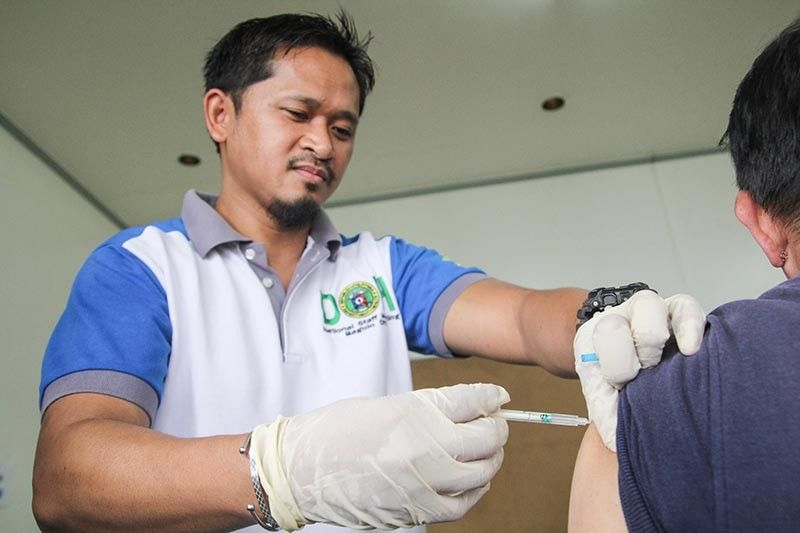 BAGUIO. A health worker conducts free flu vaccination in Baguio City as Cordillera is closely monitoring dengue and measles cases in the region. (Photo by Jean Nicole Cortes)