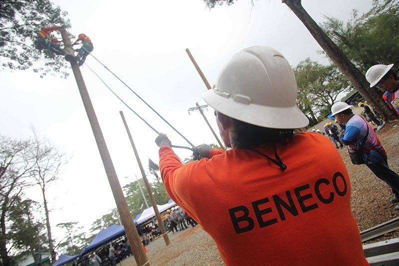BAGUIO. Linemen from different cooperatives in Northern Luzon compete in pole dressing and pole undressing among other tournaments during the first national competition for linemen in Baguio City on July 23 to 24, 2019. Photo by Jean Nicole Cortes