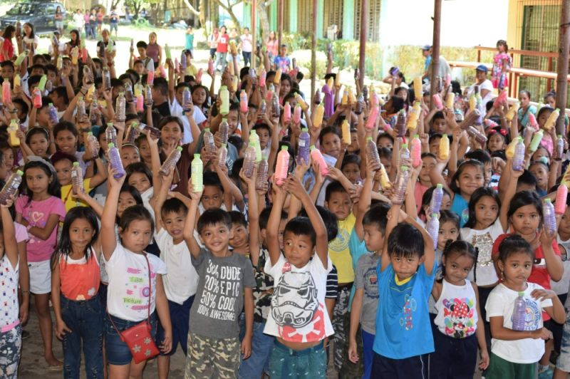 BACOLOD. The pupils of La Granja Elementary School in La Carlota City avail the milk feeding program of the Provincial Veterinary Office at the Provincial Livestock Breeding Center and Dairy Farm at Barangay La Granja in the said city Saturday, July 20, 2019. (Contributed photo)