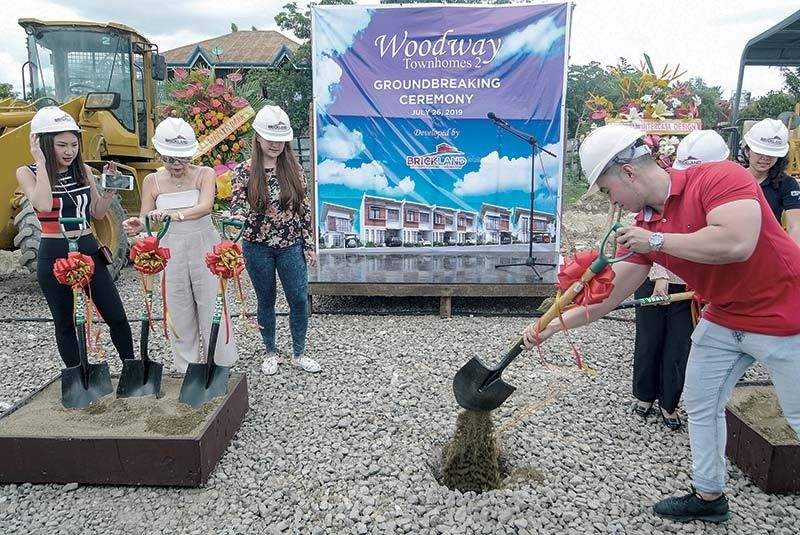 PHASE 2. Brickland Property Ventures Corp. president Brixcy Yu (third from left) witnessed the ceremonial groundbreaking for Phase 2 of the Woodway Townhomes in Barangay Pooc, Talisay City, Friday, July 26, 2019. The  P50-million project is expected to be completed by the last quarter of 2023. (SunStar Photo/Arni Aclao)