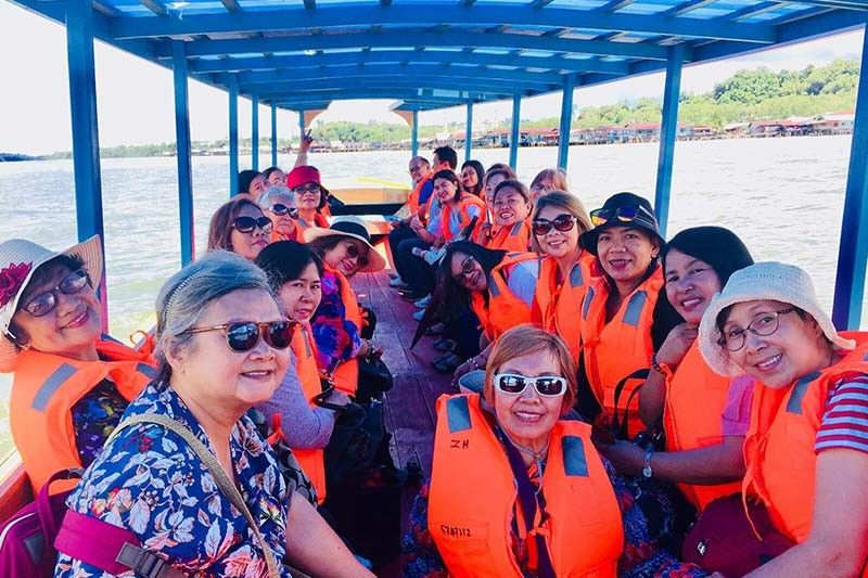 "GSP delegates were ferried to the ""Water Village"" (Kampong Ayer). (Debb Bautista)"