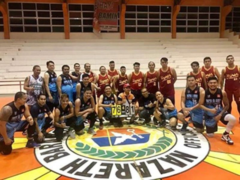 CAGAYAN DE ORO. The ageless Team Gabe (blue jersey) overcomes the youth-laden Team Nobles (red uniform), 81-76 in their NMR-IV Eagles cage semis match at the Nazareth gym, Cagayan de Oro City. (Contributed photo)
