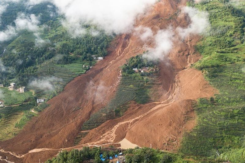 BEIJING. This photo released by Xinhua News Agency shows a landslide site in Pingdi Village in Shuicheng County of Liupanshui City, southwestern China's Guizhou Province Wednesday, July 24, 2019. Authorities say at least a dozen people have died in two landslides in southwestern China and a rescue operation is underway for missing. (AP Photo)