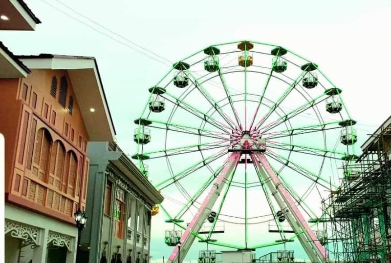 The ferris wheel is a 25-meter high with a capacity of 108 persons. It is equipped with 18 standard open gondolas that can hold six passengers each. This offers a scenic view of Silay City and beyond when one reaches the highest point. (Contributed Photo)