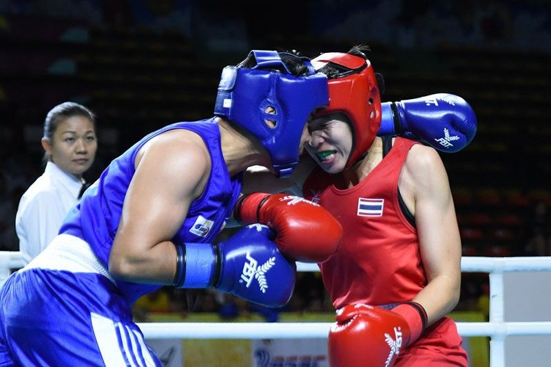 THAILAND. Nesthy Alcayde Petecio (left), whose amateur boxing career began in Davao City several years ago, and Thailand's Nilawan Techasuep battle in their 2nd Thailand Open Boxing Championships women's 57 kilograms division finals at the National Stadium in Bangkok, Thailand. (ASBC)