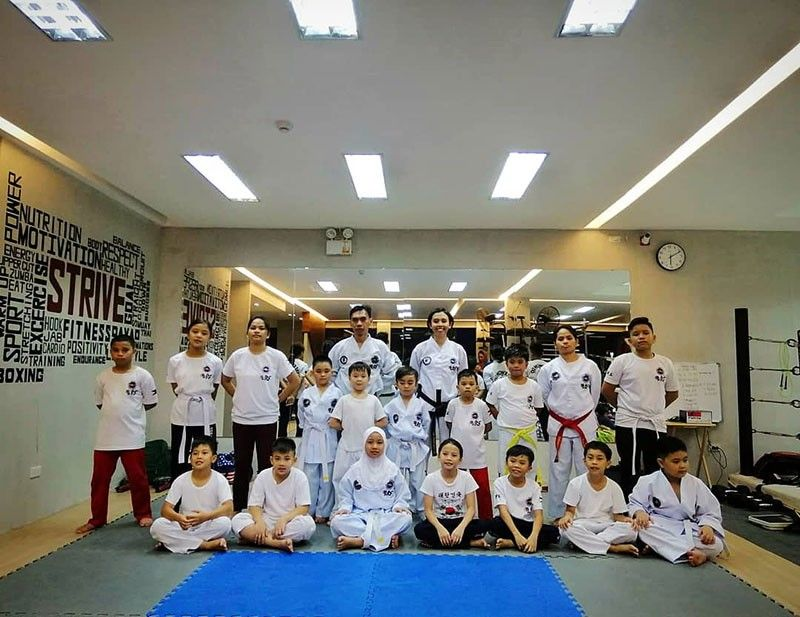 DAVAO. Taekwon-do students with Taekwon-do Coaches Junno Hiramis and Jan Marie Balayo. (Andrea Isabelle Mejos)