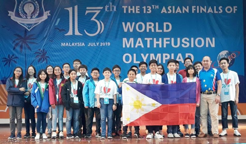 MALAYSIA. Triumphant Filipino students display the Philippine flag at the awarding ceremony of the 13th Asian Finals of the World Math-Fusion Olympiad in Malaysia. (Photo by MathDAP)