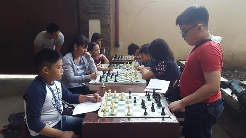 CAGAYAN DE ORO. Corpus Christi chessers prepare themselves for the Parents Chess Club tourney on August 10 at the Limketkai Mall, Cagayan de Oro City. (Lynde Salgados)