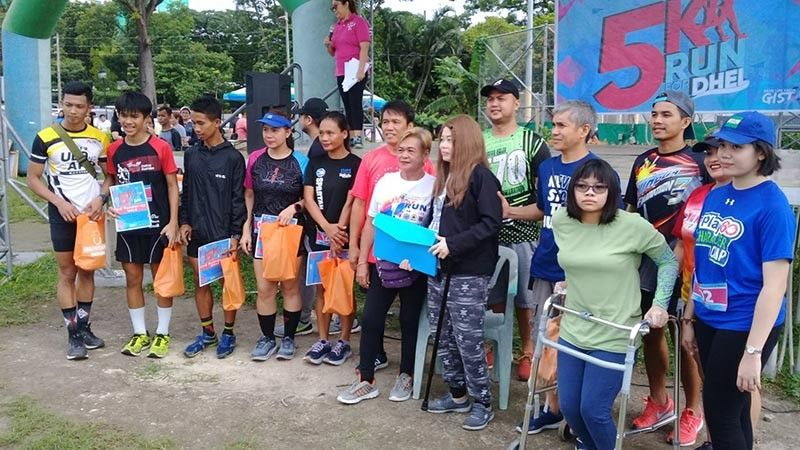 "PAMPANGA. Representatives from various organizations and CDC employees recently participated in ""5k Run for Dhel"" held at the Clark Parade Grounds. In the photo is Adelina Acla and some of the runners who took part in the event. (CDC-CD Photo)"