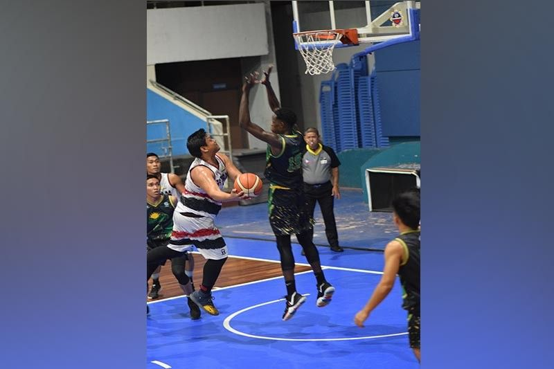 DAVAO. Paul Namuag of H Team drives to shoot against Soulymane Diouf of Jade Green/Ateneo during their game in the first Mindanao Banana Farmers and Exporters Association (Mbfea) Basketball League at Rizal Memorial Colleges (RMC) Petro Gazz Arena over the weekend. (Basketball Avenue)