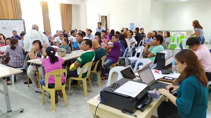 NEGROS. They assess the impact of climate change and calamities in the rural and urban areas of the city during the Climate and Disaster Risk Assessment Workshop held on July 17-18 at the Social Hall of the Sipalay City Government Center. (Contributed photo)