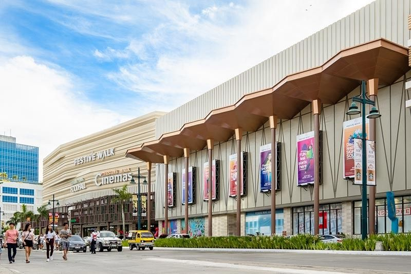 NEGROS OCCIDENTAL. A day shot of the Festive Walk Mall in Iloilo City, one of the Lifestyle Malls of property giant Megaworld Corp. (Contributed Photo)