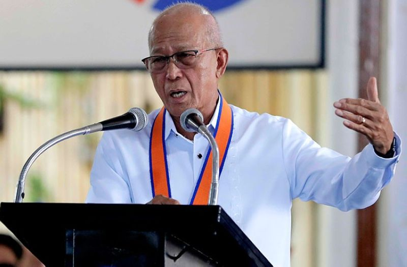 MANILA. In this July 25 file photo, Philippine Defense Secretary Delfin Lorenzana gestures while addressing the Philippine Coast Guard during turnover and blessing ceremony of several coast guard assets at their headquarters in Manila. (AP)