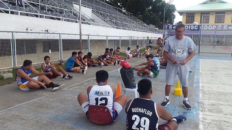 CAGAYAN DE ORO. Grizzled coach Oscar Abucejo, a stroke survivor, continues to be a boon to local sports development as he perseveres in training young and budding basketball players at the Pelaez Sports Center, Cagayan de Oro City. (Lynde Salgados)