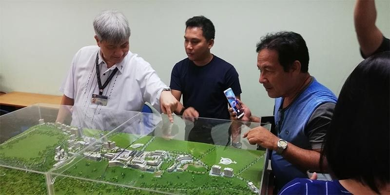 CAGAYAN DE ORO. Xavier University president Fr. Bobby Yap looks at the project perspective of the new campus of the university which will be built in Manresa property, uptown Cagayan de Oro. Yap said the Divisoria area has become too congested and noisy for the convenience of students. (Photo by PJ Orias)