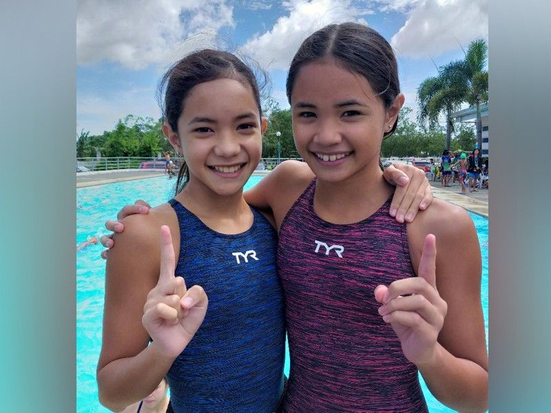 DAVAO. Bemedaled swimming sisters Liaa Margarette and Lora Micah Amoguis are among the heavy favorites in Davao City's Batang Pinoy 2019 National Championships bid. (Photo by Marianne L. Saberon-Abalayan)
