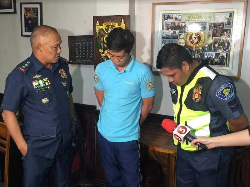 MANILA. Police-Integrity Monitoring and Enforcement Group (IMEG) Director Romeo Caramat chides Patrolman John Lagao Felix and Traffic Enforcer Jason Parcon after their arrest on August 1, 2019. (Contributed Photo)