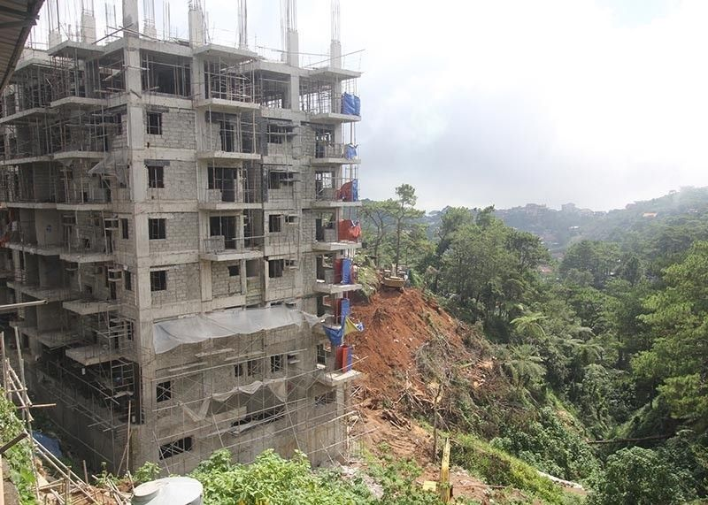 BAGUIO. The ongoing construction of a high-rise building owned by Moldex Realty in Baguio City has prompted environmentalists to call the attention of the city following the cutting of trees in the area. (Jean Nicole Cortes)