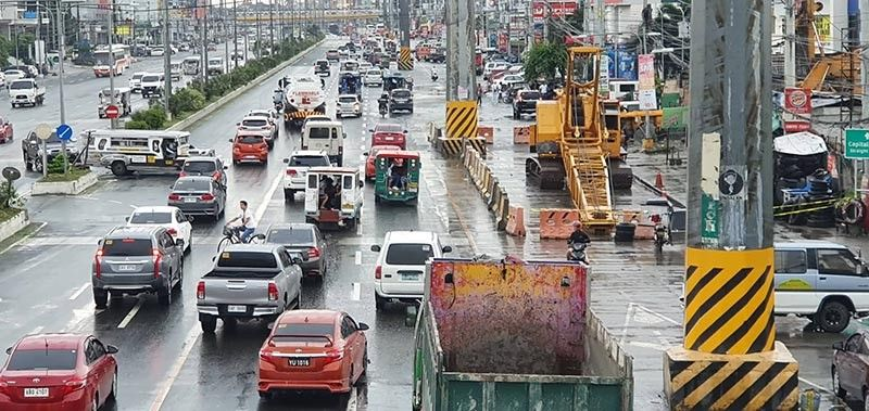 PAMPANGA. Heavy equipment of the National Grid Corporation of the Philippines (NGCP) can be seen along the Jose Abad Santos Avenue (JASA) in the City of San Fernando as the NGCP starts the relocation of high-voltage transmission lines standing along JASA. - Chris Navarro