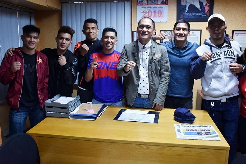 BAGUIO. Team Lakay fighters pay a courtesy call to City Councilor Michael Lawana several days before their fight in ONE: Dawn of Heroes on August 2 at the Mall of Asia Arena. In the photo are (L-R) Danny Kingad, ONE Straw weight Champion Joshua Pacio, Edward Kelly, former ONE Flyweight Geje Eustaquio, former ONE Lightweight Champion Eduard Folayang and former ONE Featherweight Champion Honorio Banario. (Redjie Melvic Cawis)
