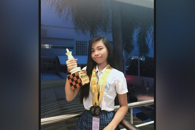 DAVAO. Queenie Peralta of Davao Wisdom Academy (DWA) poses with the high school girls champion's at the close of the 10th JVR Inter-School Invitational Chess Team Championships held recently at the Emcor Office, J.P. Laurel Avenue in Davao City. (Jasmine Amoncio Facebook)