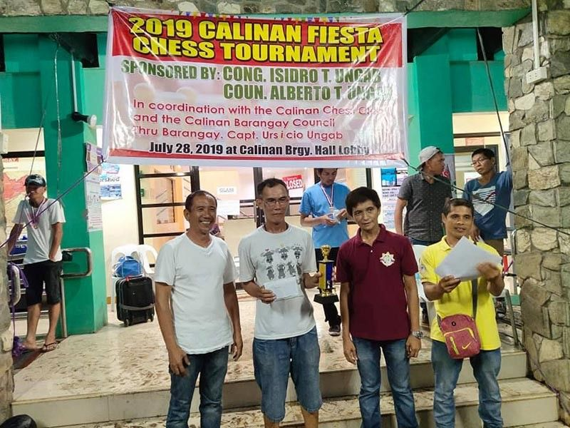 DAVAO. Danilo Lee (second from left) receives his champion's trophy and cash prize for topping the open division of the 2019 Calinan Fiesta Chess Tournament held recently at the Calinan Barangay Hall. (Ely Acas's Facebook account)