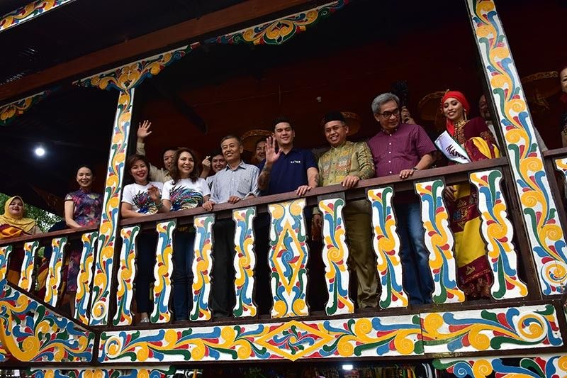 DAVAO. Davao City Acting Mayor Sebastian Duterte waves to the crowd as he visits the Torogan Tribal House of the Maranao Tribe during Friday's (August 2, 2019) opening of Kadayawan Festival at Magsaysay Park in Davao City together with Maranao Deputy Mayor Randy Usman, city councilors, members of the diplomatic corps and the private sector. (Macky Lim)