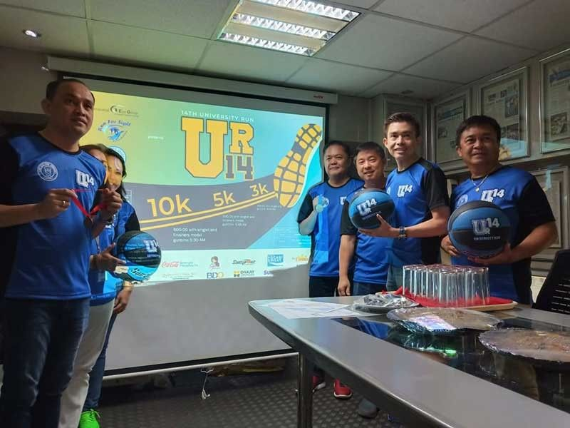 ANNUAL RACE. Dr. Potenciano Larrazabal III (second from right) and the rest of the organizers of the University Run will also hold a water booth contest during the event. (SunStar Photo/Richiel S. Chavez)