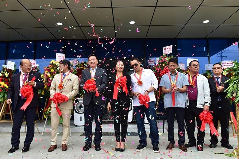MEETING DEMANDS. Jinyi has recently opened its newest office in Davao City in a bid to offer those in the construction industry quality equipment and at the same time good services. Present during the opening were (from left) Jinyi Manila officer Lucio Lao, XCMG International manager Liu Jien Sen, and Jinyi operations manager Alice Fong. (Macky Lim)