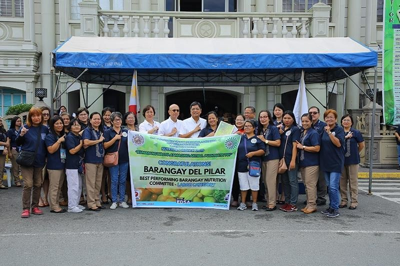 PAMPANGA. City of San Fernando Mayor Edwin Santiago and Vice Mayor Jimmy Lazatin, together with the City Nutrition Council, pose for a photo with the officials and health workers of Barangay Del Pilar which was awarded as Best Performing Barangay Nutrition Committee for large category. The awarding was held during the flag ceremony in front of the city hall on Monday, August 5, 2019. (Contributed Photo)