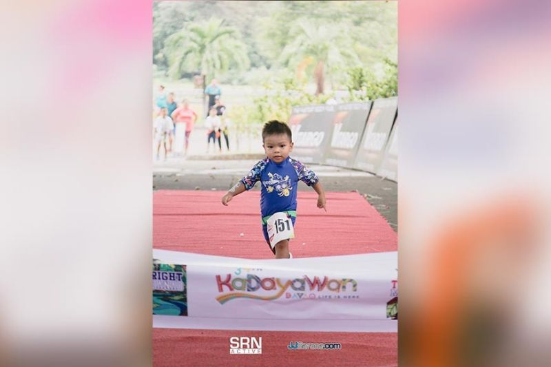 DAVAO. Two-year-old Petros Arenas reaches the finish line to place third in male six years old and below division and clinch the youngest participant honors of the just-concluded 34th Kadayawan Sports Festival Triathlon 2019, which was relegated to a duathlon as swimming stage was cancelled due to strong waves, at the Villa Josefina Resort Village in Toril, Davao City. (Photo from SRN active Facebook)