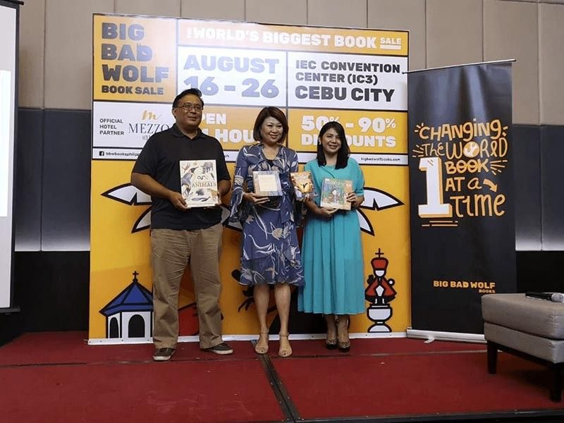 BIG LOVE FOR BOOKS. Big Bad Wolf announces its comeback to Cebu on Aug. 16 to 26, 2019 at the IEC Convention Center. Jacqueline Ng, founder of the Big Bad Wolf Book Sale (center), says over one million new English titles are for sale at 50 to 90 percent discounts. With Ng are Gawad Kalinga representative Toby Florendo (left) and Narisa dela Peña, country manager of Big Bad Wolf Books Philippines. (Photo from Big Bad Wolf's FB page)