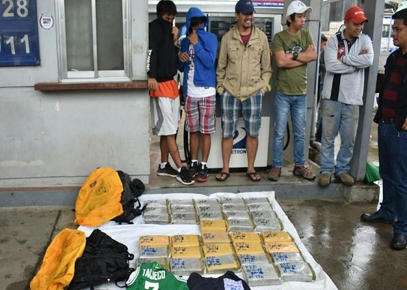 "BAGUIO. Anti–narcotics agents conduct an inventory of the marijuana bricks confiscated inside a bus bound for Baguio. Authorities are alarmed over the increasing incidents where several ""tourists"" have been arrested in the past days who are from Metro Manila and have travelled to the region bringing with them marijuana. (Tublay Police photo)"