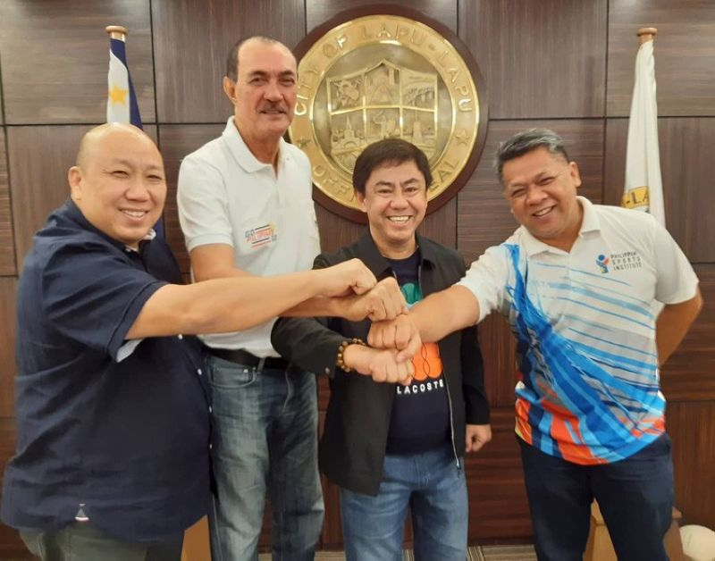 Philippine Sports Commission (PSC) commissioner Ramon Fernandez (second, from left) meets with Lapu-Lapu City Mayor Junard