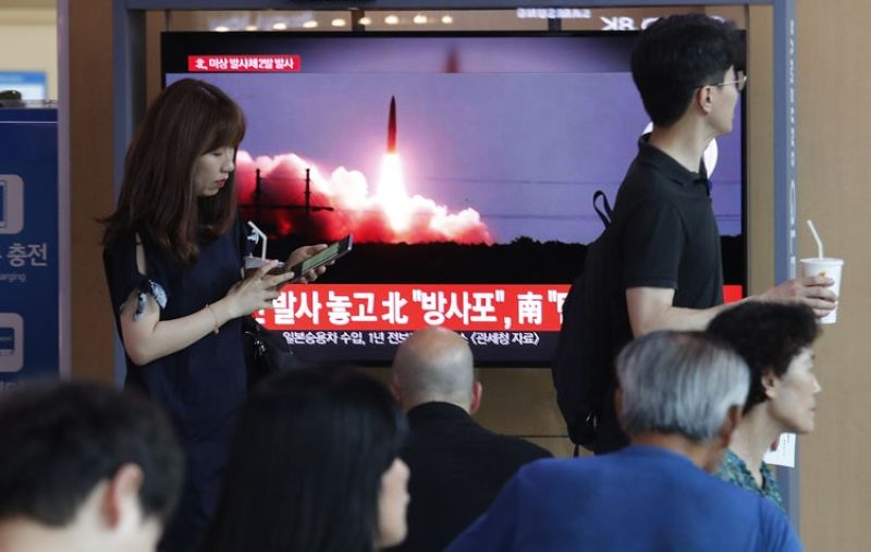 SEOUL, SOUTH KOREA. People watch a TV showing a file image of North Korea's missile launch during a news program at the Seoul Railway Station in Seoul, South Korea, Tuesday, Aug. 6, 2019. North Korea on Tuesday continued to ramp up its weapons demonstrations by firing unidentified projectiles twice into the sea while lashing out at the United States and South Korea for continuing their joint military exercises that the North says could derail fragile nuclear diplomacy. The sign reads
