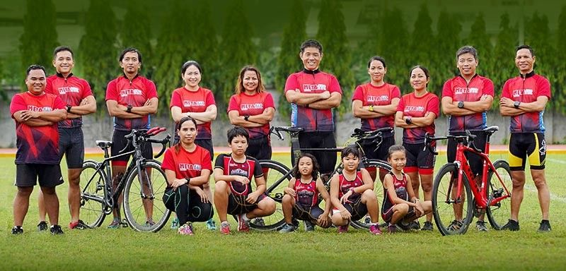 GOING FOR PR. The members of the MetaFit Tri Team and the MetaFit Kids pose are all ready for the Ironman 70.3 on Aug. 11 and Ironkids Philippines on Aug 10 in Lapu-Lapu City. (Contributed photo)