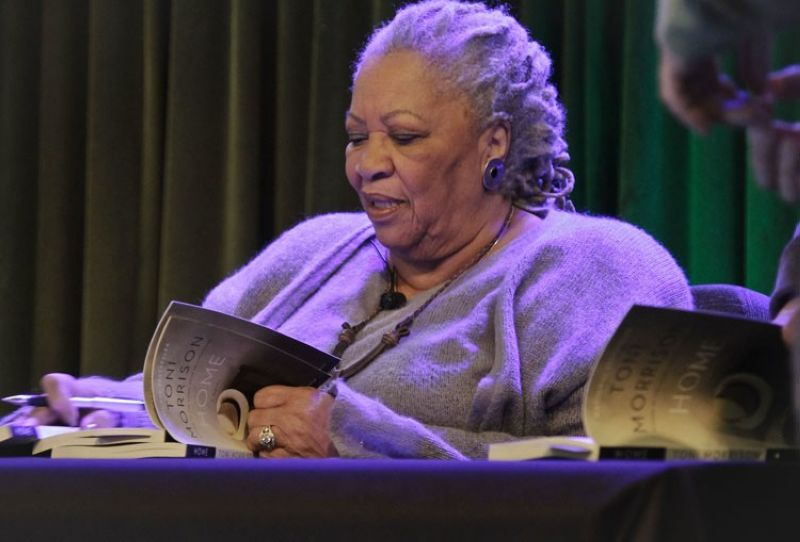 NEW YORK. In this February 27, 2013 file photo, author Toni Morrison signs copies of her latest book