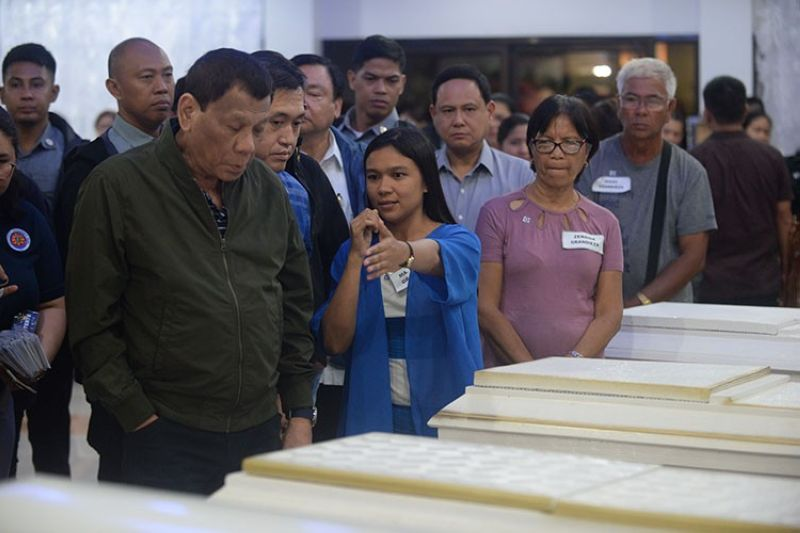 ILOILO. Maria Nieves Grandieza points to the caskets bearing the bodies of members of the Baguio family, as President Rodrigo Duterte visits Wednesday, August 7, 2019, the victims of the sinking of motorized bancas in Iloilo-Guimaras Strait. At least 13 bodies are at the Gegato Abecia Funeral Homes in Jaro, Iloilo. (Leo Solinap)