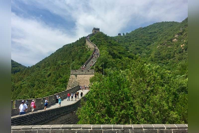 RECORD HOLDER. The Great Wall of China, a Unesco World Heritage Site, is undoubtedly one of the country's famous historic structures. It is the world's longest wall measuring 21,196.18 kilometers. (Photo by Carlo S. Lorenciana)