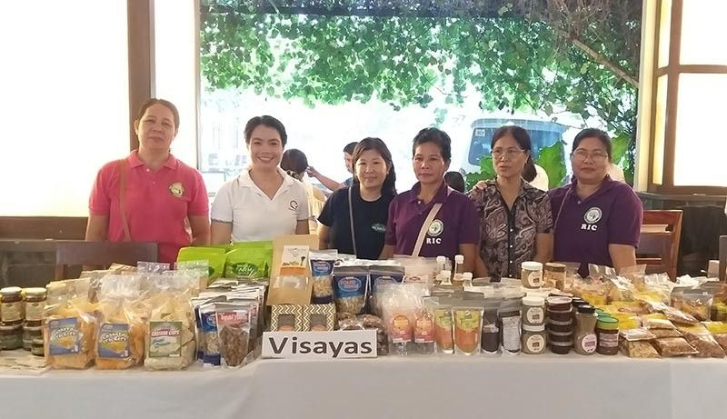 BACOLOD. Some of the members of various rural improvement clubs in Negros Occidental are getting boost through a product exhibit at the ongoing 5th Farm Home Extensionist Association of the Philippines National Congress at the Nature's Village Resort in Talisay City. These women-members are being assisted by Fhexap to become entrepreneurs. (Erwin P. Nicavera)
