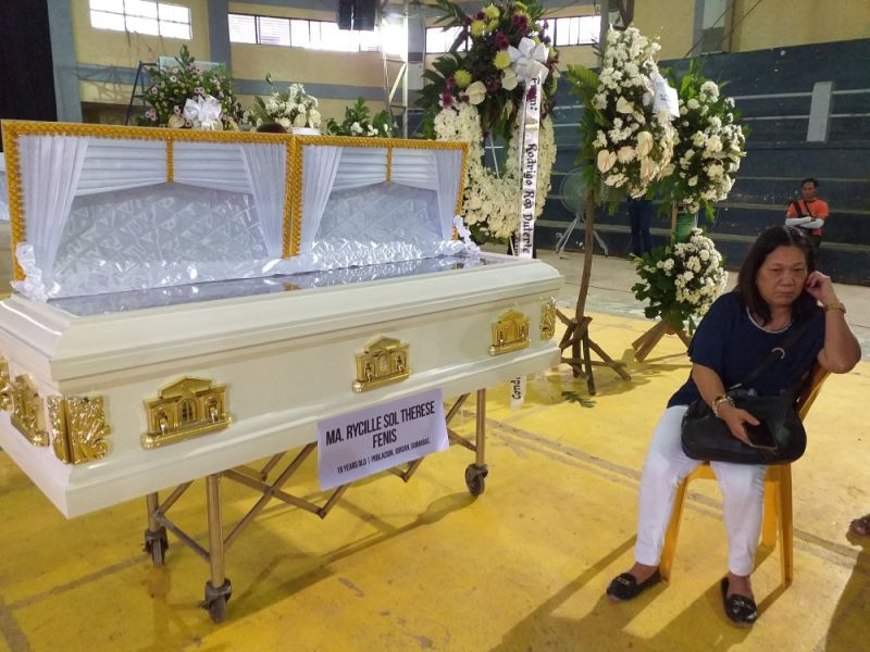 ILOILO. Cecilia Fenis at the Guimaras Provincial Multipurpose Gym where the body of her daughter, Reycille Sol Therese Fenis, was housed Wednesday, August 7, 2019. (Carolyn Abello)