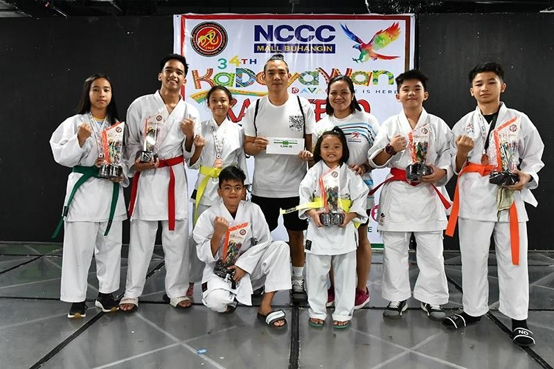 JUNIORS DIVISION. Panabo City karatekas celebrate their overall championship victory in the juniors division of the recently-concluded 34th Kadayawan Sports Festival Karatedo Invitational Tournament held at NCCC Mall Buhangin. (Skippy Lumawag/SDD-CMO)